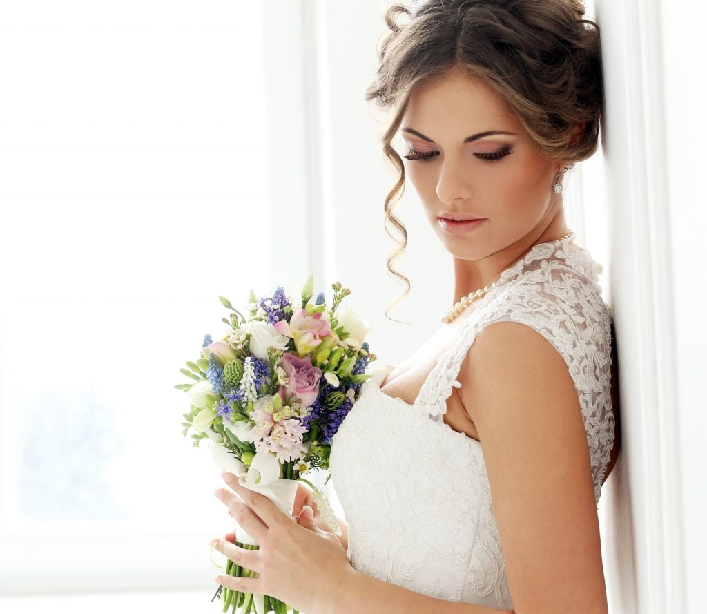 Beautiful bride with bouquet
